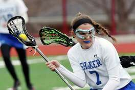 Shaker's Lauren Martuscello (7) moves the ball against Cicero-North Syracuse during a girls high school lacrosse game in Watervliet, N.Y., Saturday, April 8, 2017. (Hans Pennink / Special to the Times Union) ORG XMIT: HP101
