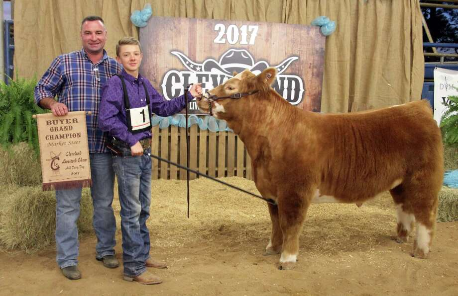 At the youth livestock auction for Cleveland Livestock Show and Dairy Day on Friday, April 7, Chase Anderson of Tarkington Jr. FFA sold his Grand Champion Market Steer, which weighed in at 1,115 pounds, for $15,000 to Trey Harris of Colony Ridge Development. Photo: Vanesa Brashier
