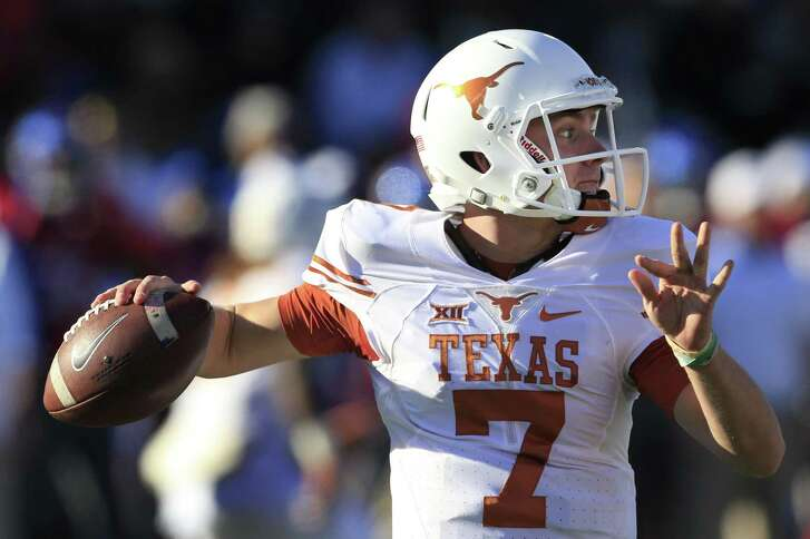FILE - In this Saturday, Nov. 19, 2016, file photo, Texas quarterback Shane Buechele passes to a teammate during the first half of an NCAA college football game against Kansas in Lawrence, Kan. Buechele threw for 2,958 yards and 21 touchdowns as a freshman and will likely be in the 2017 Heisman race. (AP Photo/Orlin Wagner, File)