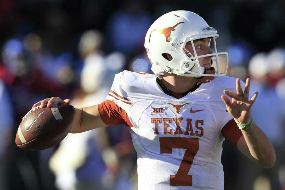 FILE - In this Saturday, Nov. 19, 2016, file photo, Texas quarterback Shane Buechele passes to a teammate during the first half of an NCAA college football game against Kansas in Lawrence, Kan. Buechele threw for 2,958 yards and 21 touchdowns as a freshman and will likely be in the 2017 Heisman race. (AP Photo/Orlin Wagner, File) Photo: Orlin Wagner, STF / Associated Press / Copyright 2016 The Associated Press. All rights reserved.