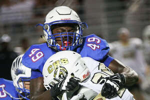 Oak Ridge's Joseph Ossai (49) tackles Conroe's Donaven Lloyd (20) during the varsity football game on Friday, Sept. 16, 2016, at Woodforest Stadium in The Woodlands, Texas. Ossai has fielded offers from programs like Texas A&M University, Alabama and Baylor, and his Twitter presence is exactly what Oak Ridge coaches Will Compton and Kevin Goodwin strive to get their players to emulate. ( Michael Minasi / Chronicle )