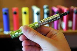 The electronic cigarette consists of a battery on the bottom and a bottom-coiled tank on top. Smokers have turned to the device to help kick the habit.