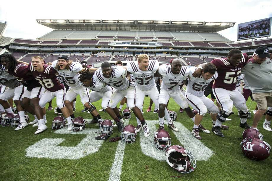 The Texas A&M football team gather on the field to sing following the Texas A&M spring football game at Kyle Field on Saturday, April 8, 2017, in College Station. ( Brett Coomer / Houston Chronicle ) Photo: Brett Coomer/Houston Chronicle