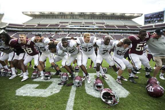 The Texas A&M football team gather on the field to sing following the Texas A&M spring football game at Kyle Field on Saturday, April 8, 2017, in College Station. ( Brett Coomer / Houston Chronicle )