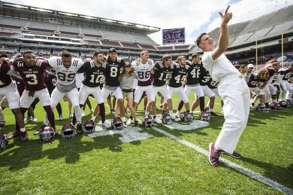 Texas A&M yell leader Cooper Cox, of Houston, leads the Aggie football team in signing the Aggie War Hymn during the Texas A&M spring football game at Kyle Field on Saturday, April 8, 2017, in College Station. ( Brett Coomer / Houston Chronicle )