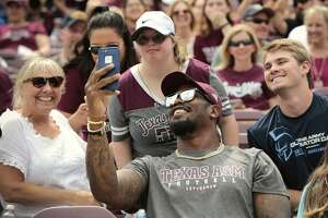 Denver Broncos linebacker and Texas A&M alumn Von Miller poses for photos with Aggies fans during the Texas A&M spring football game at Kyle Field on Saturday, April 8, 2017, in College Station. ( Brett Coomer / Houston Chronicle )