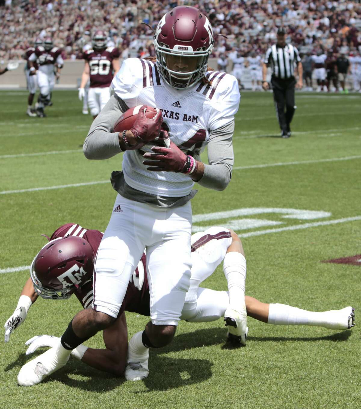 Texas A&M receiver Kendrick Rogers (84) comes down with a 16-yard touchdown reception over defensive back Travon Fuller during the Texas A&M spring football game at Kyle Field on Saturday, April 8, 2017, in College Station. ( Brett Coomer / Houston Chronicle )