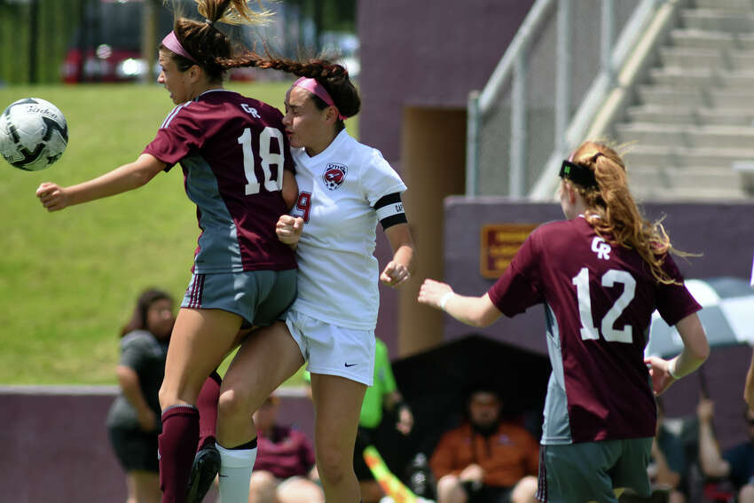 Cinco Ranch senior midfielder Shayla Anaya (18) battles for the ball against Tompkins senior midfielder JoAnnie Ramos during the 2nd half of their Girls Region III-6A Soccer Final at Abshier Stadium in Deer Park on Saturday, April 8, 2017. (Photo by Jerry Baker/Freelance)