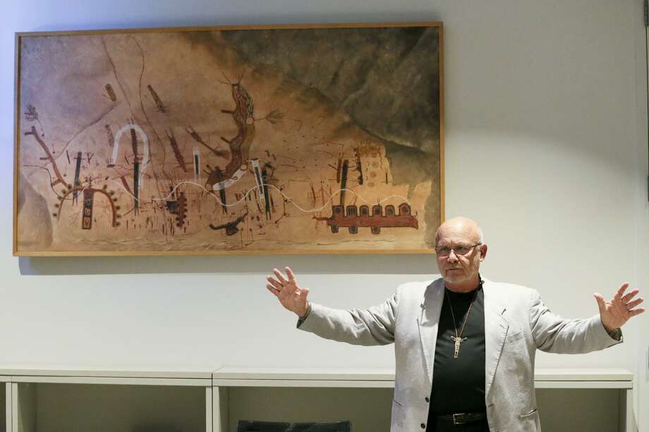"""Greg Williams, CEO of The Rock Art Foundation, talks about a reproduction of the White Shaman (pictured), that he described as """"one of the greatest narratives in the world,"""" during a press conference at the Witte Museum's B. Naylor Morton Research and Collections Center on Sept. 28, 2016, to announce that the Witte Museum was taking over administration of the White Shaman Preserve in the Lower Pecos Canyonlands from the Rock Art Foundation. The Witte already had more than 20,000 artifacts from the preserve in its collections. The White Shaman is projected onto a rock wall in the Kittie West Nelson Ferguson People of the Pecos Gallery at the Witte. Photo: Marvin Pfeiffer /San Antonio Express-News / Express-News 2016"""