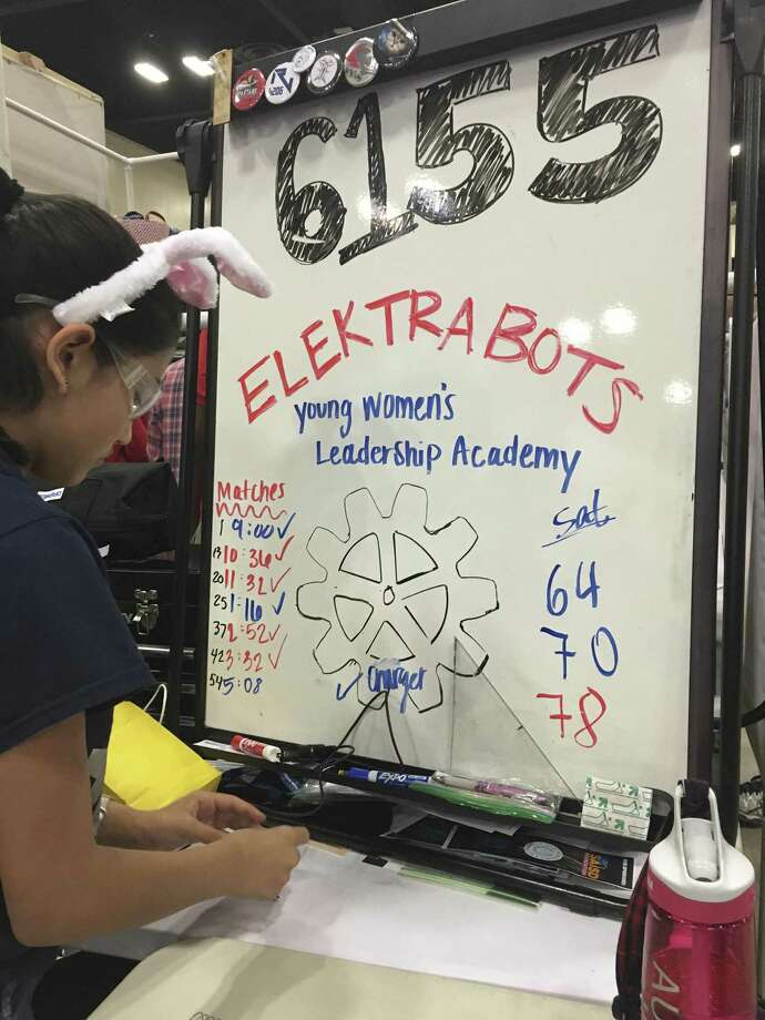 A Young Women's Leadership Academy student tidies the ElektraBots workspace at the FIRST Robotics Competition Alamo Regional on April 7, 2017. Photo: Lauren Caruba, San Antonio Exprss-News