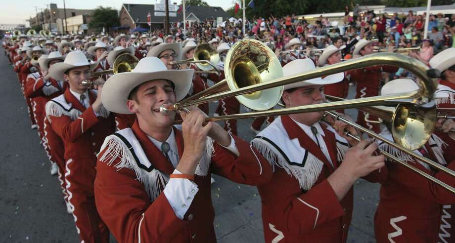 The University of Texas Longhorn Band will lead this year's Fiesta Flambeau Parade starting at 7:31 p.m. on Saturday, April 29. Photo: Edward A. Ornelas /San Antonio Express-News / © 2016 San Antonio Express-News