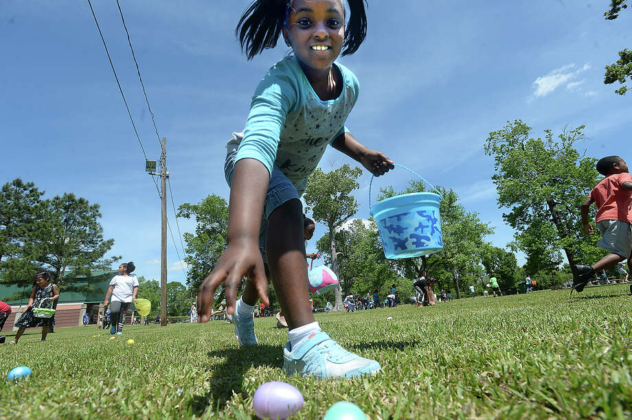 Children scramble toward the treats that await during the City of Beaumont's annual Easter Egg Hunt in Magnolia Park Saturday. Children scrambled throughout the grounds, quickly filling baskets and bags with colorful, treat-filled eggs.  Photo taken Saturday, April 8, 2017 Kim Brent/The Enterprise Photo: Kim Brent / BEN