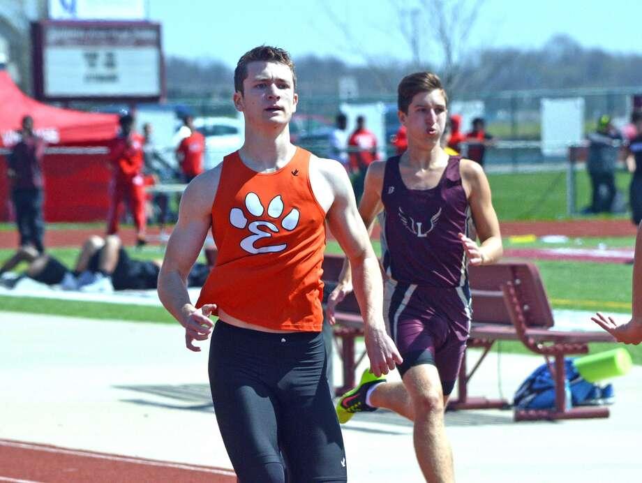 Edwardsville senior Matt Swanson, left, competes in the 400-meter run.