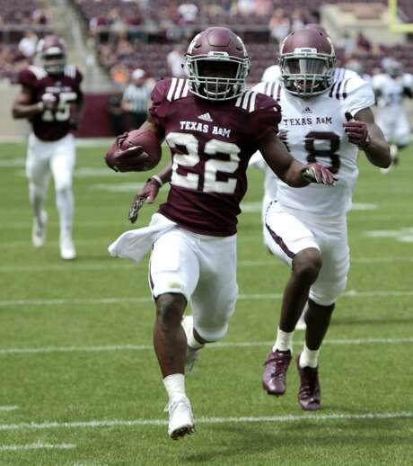 Texas A&M running back Kwame Etwi (22) breaks away from defensive back Kemah Siverand (18) on a long gain up the sidelines during the Texas A&M spring football game at Kyle Field on Saturday, April 8, 2017, in College Station. ( Brett Coomer / Houston Chronicle ) Photo: Brett Coomer, Staff / Houston Chronicle / © 2017 Houston Chronicle