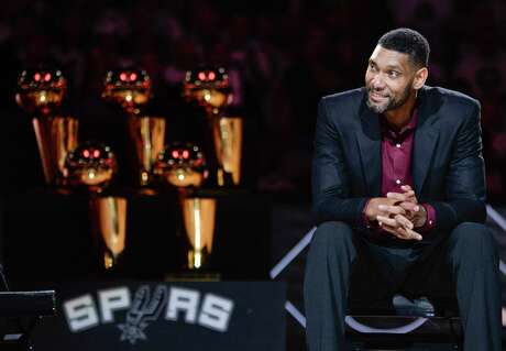 Former Spurs great Tim Duncan appreciates the speakers' comments about him during his jersey retirement ceremony Dec. 18, 2016.