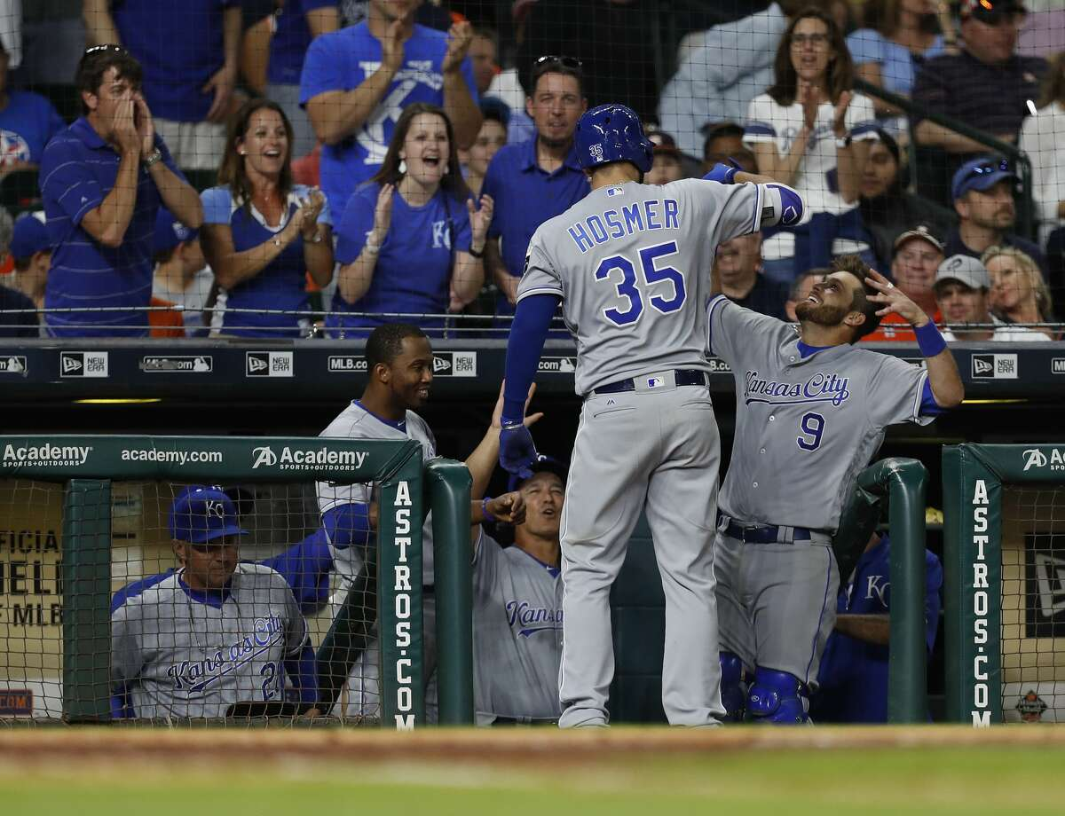 Kansas City Royals first baseman Eric Hosmer (35) celebrates his two-run home run with Drew Butera (9) during the eighth inning of an MLB baseball game at Minute Maid Park, Saturday, April 8, 2017, in Houston. ( Karen Warren / Houston Chronicle )