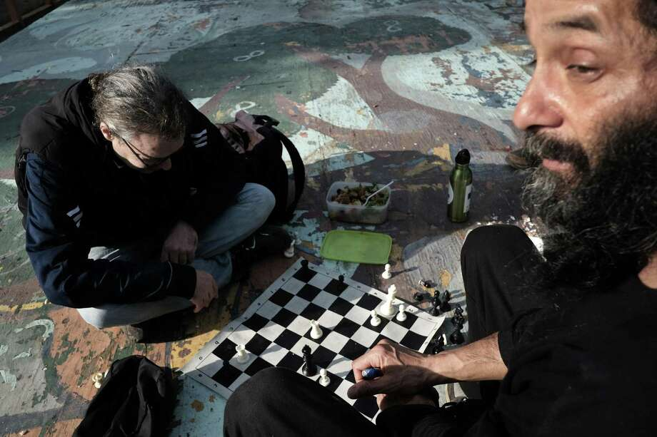 Erich Corbin, left, and Condor Twinkles play chess at People's Park in Berkeley, CA, on Tuesday March 7, 2017. Photo: Michael Short / Special To The Chronicle / Michael Short 2017