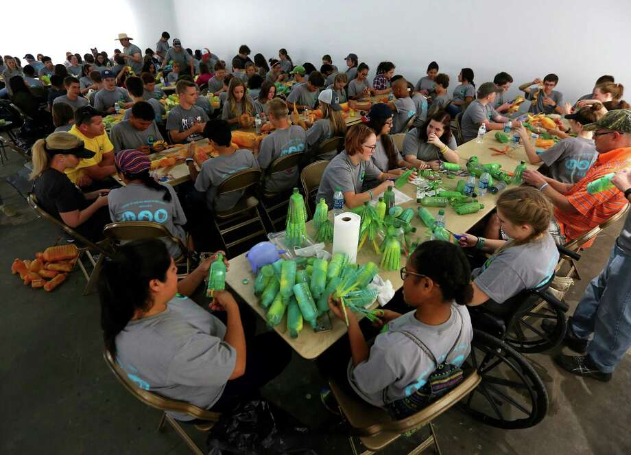 "More than 200 teens from Houston-area Mormon churches painted, cut and created ""flowers"" out of used water bottles Saturday. The flowers are to be part of local artist Carol Simon's  ""First Ward is Blooming"" project. Photo: Annie Mulligan, Freelance / @ 2017 Annie Mulligan & the Houston Chronicle"