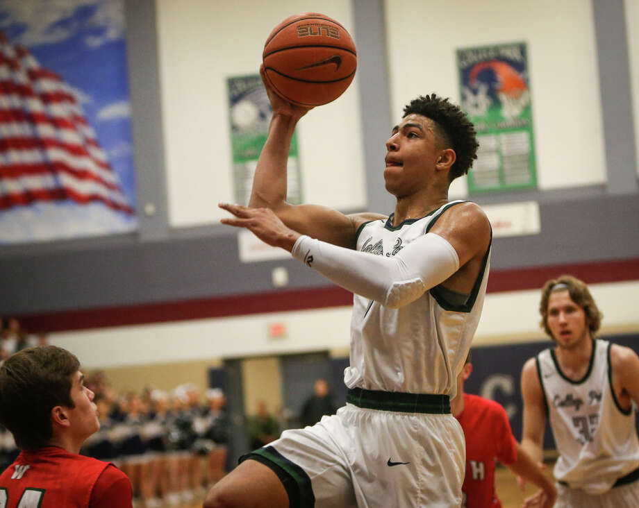 College Park's Quentin Grimes (5) shoots during the varsity boys basketball game against The Woodlands on Tuesday, Jan. 24, 2017, at College Park High School. (Michael Minasi / Chronicle) Photo: Michael Minasi, Staff Photographer / © 2017 Houston Chronicle