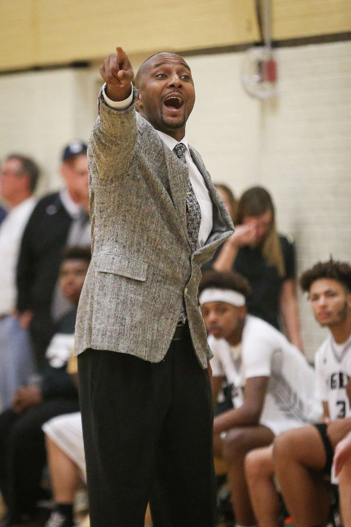 Conroe head coach Daryl Mason guides his team from the sideline during the varsity boys basketball game against Oak Ridge on Friday, Jan. 13, 2017, at Conroe High School. (Michael Minasi / Chronicle)