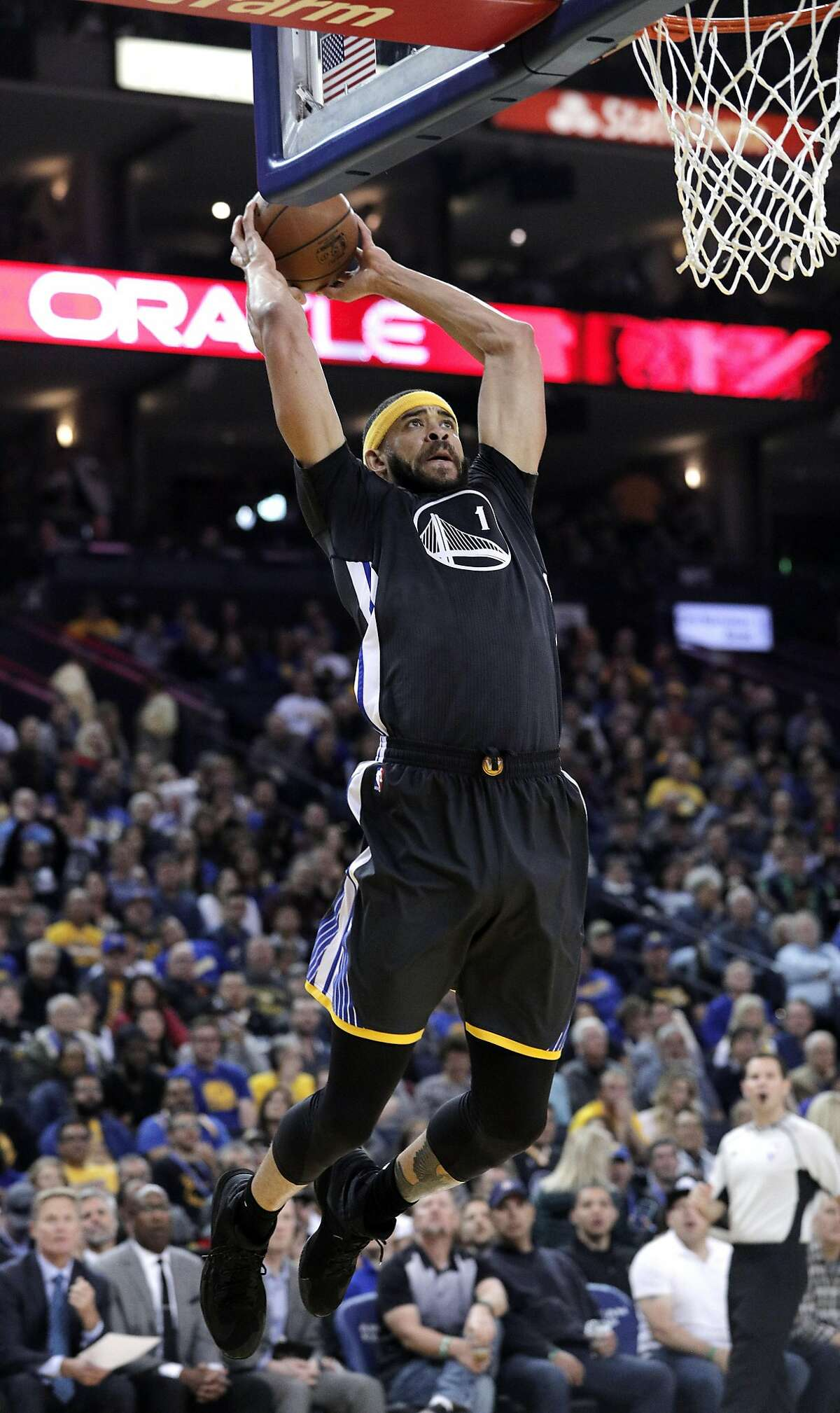 JaVale McGee (1) dunks in the first half as the Golden State Warriors played the New Orleans Pelicans at Oracle Arena in Oakland, Calif., on Saturday, April 8, 2017.
