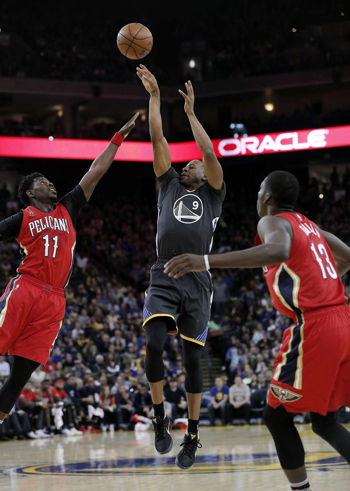 Andre Iguodala (9) puts up a buzzer beater to end the first quarter as the Golden State Warriors played the New Orleans Pelicans at Oracle Arena in Oakland, Calif., on Saturday, April 8, 2017.