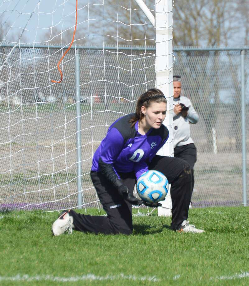 Edwardsville keeper Regan Windau scoops up a shot from Normal Community early in the second half Saturday in Normal.