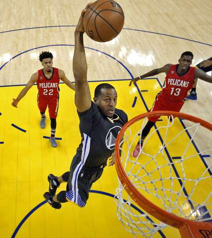 4bc1851f863 Andre Iguodala (9) dunks in the first half as the Golden State Warriors  played