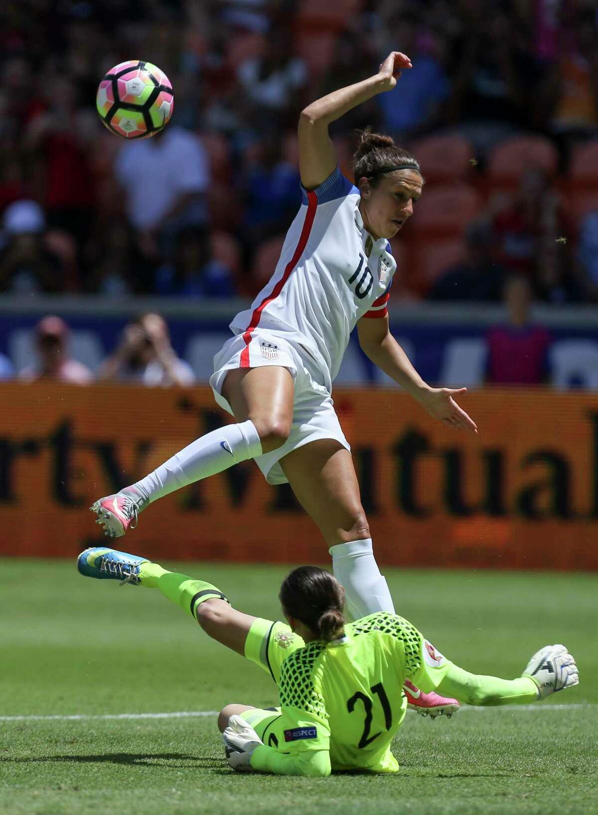 U.S.A. Carli Lloyd (10) jumps up while Russia goalkeeper Iuliia Grichenko (21) tries to get the ball away from her during the first half of the game BBVA Compass Stadium Sunday, April 9, 2017, in Houston.