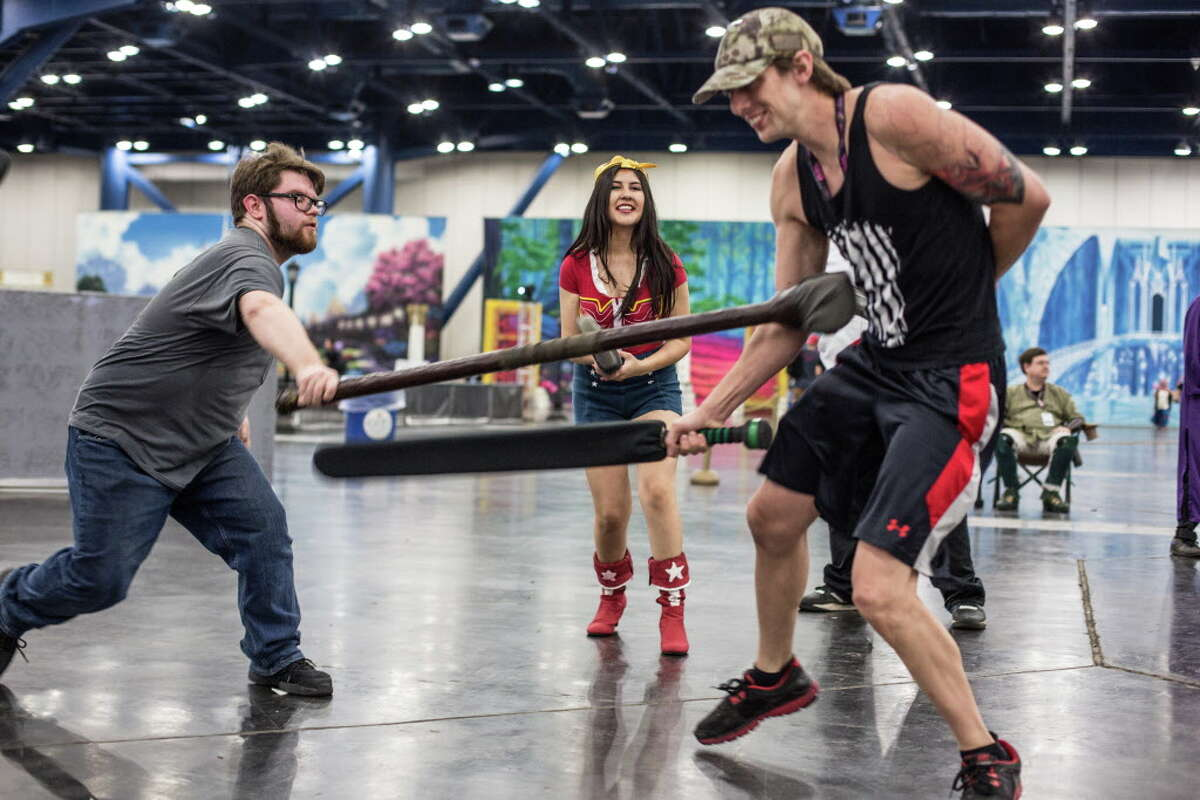 Joseph Wilson, Jennifer Calles and Jake Endert engage in live action role playing during Anime Matsuri held at George R. Brown Convention Center Friday April 7, 2017.