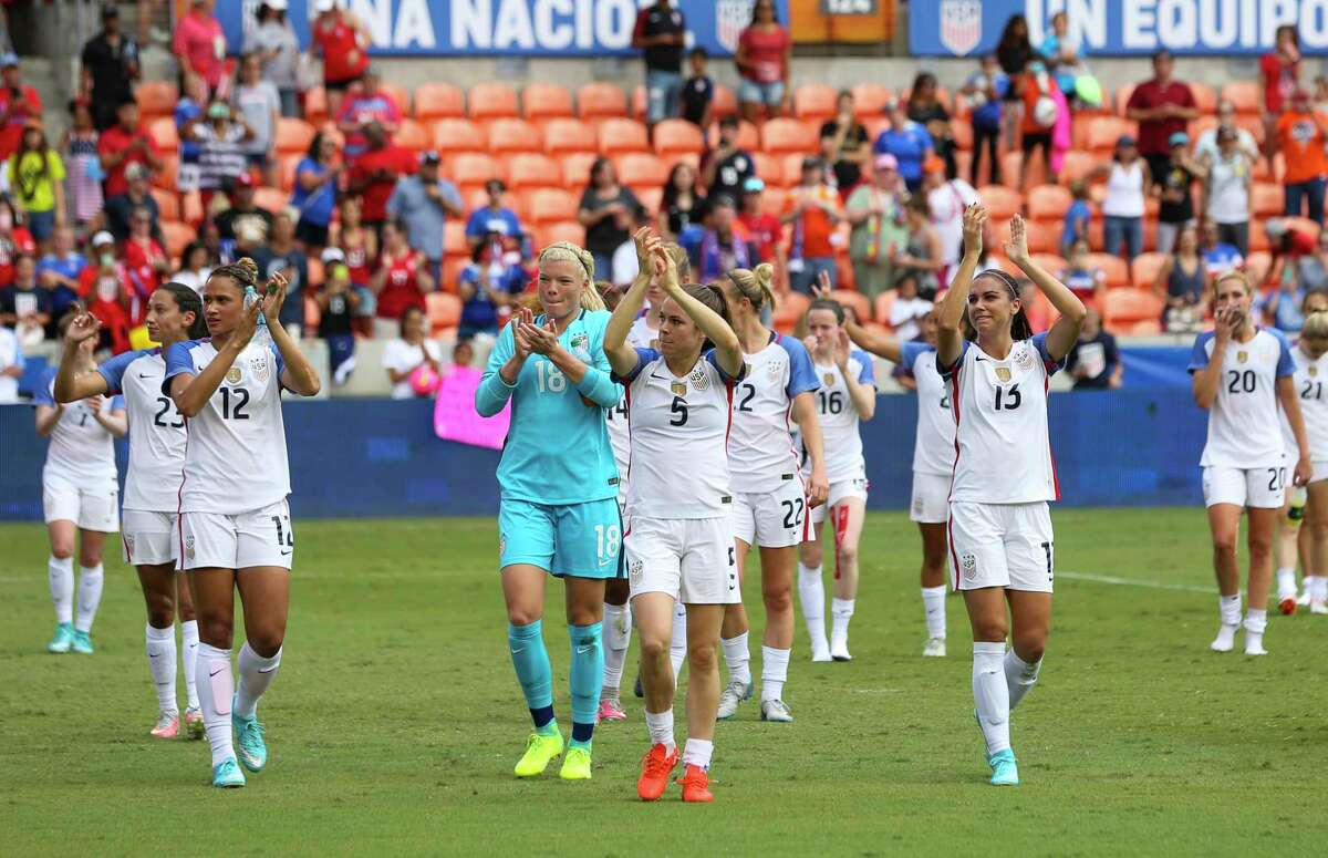 U.S.A. players, including Houston Dash's Jane Campbell, thank fans after defeating Russia at BBVA Compass Stadium Sunday, April 9, 2017, in Houston.