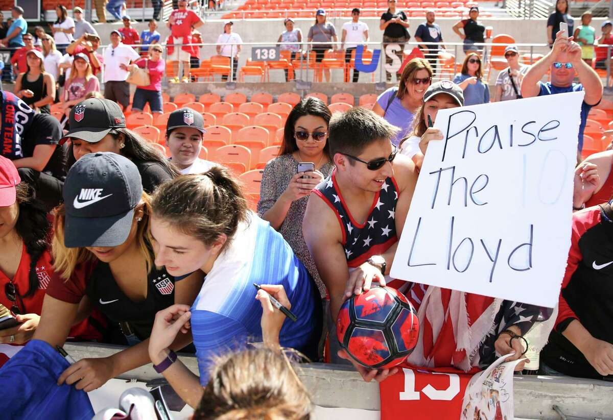 U.S.A. Carli Lloyd, also a Houston Dash player, signs for fans after the game against Russia BBVA Compass Stadium Sunday, April 9, 2017, in Houston.
