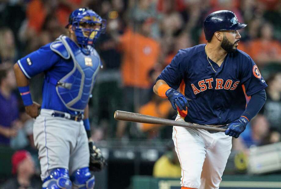 Houston Astros first baseman Marwin Gonzalez (9) watches the flight of his 2-