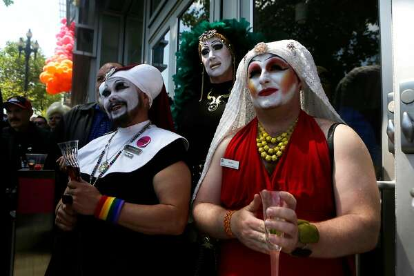 Sister of Perpetual Indulgence watch the speakers on stage at the reopening of the LGBT Center on Sunday, April 9, 2017, in San Francisco, Calif.