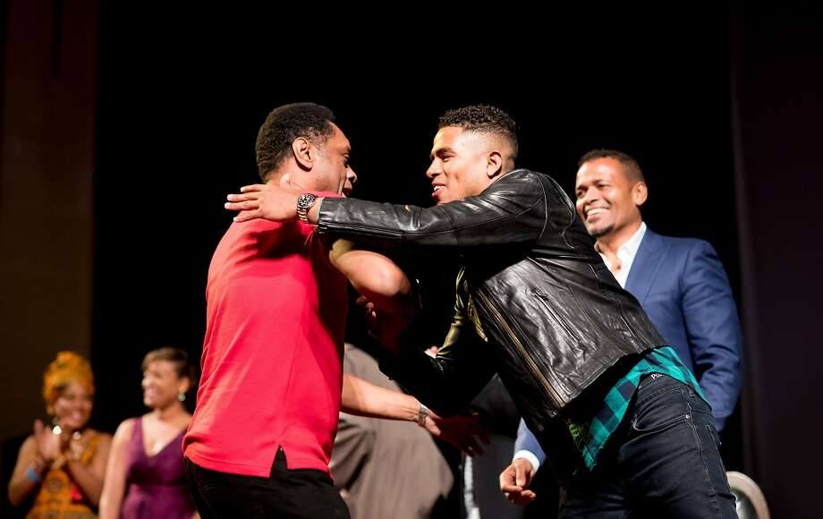"""Lawrence Hilton-Jacobs (left), who played Noah in the original """"Roots,"""" is embraced by Mandela Van Peebles, who had the same role in the 2016 remake of the miniseries. Photo: Noah Berger, Special To The Chronicle"""