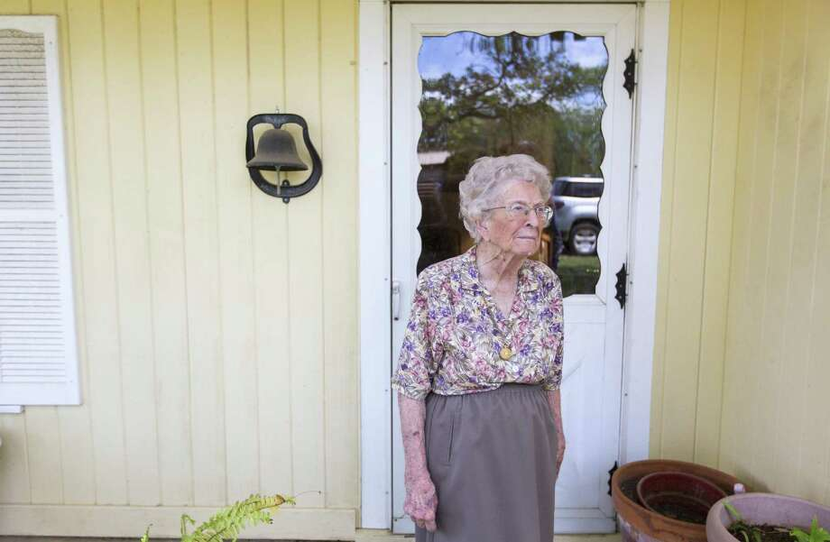 Life-long resident Modell McCoy, 97, stands April 4, 2017, on the front porch of her Rocksprings home. McCoy is one of the few people still living to experience first hand the1927 tornado that killed more than 70 people in the tiny ranching community about 100 miles west of San Antonio. Photo: William Luther, Staff / San Antonio Express-News / © 2017 San Antonio Express-News