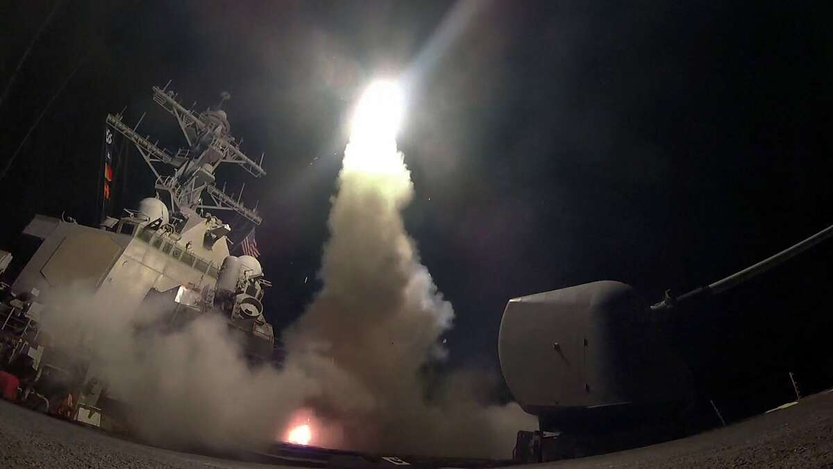 """FILE - In this Friday, April 7, 2017 file image provided by the U.S. Navy, the guided-missile destroyer USS Porter (DDG 78) launches a tomahawk land attack missile in the Mediterranean Sea as the United States blasted a Syrian air base with a barrage of cruise missiles in fiery retaliation for a gruesome chemical weapons attack against civilians earlier in the week. North Korea has vowed to bolster its defenses to protect itself against airstrikes like the ones President Donald Trump ordered against an air base in Syria. The North called the airstrikes """"absolutely unpardonable"""" and said it proves that its nuclear weapons are justified to protect the country against Washington's """"evermore reckless moves for a war."""" (Mass Communication Specialist 3rd Class Ford Williams/U.S. Navy via AP, File)"""
