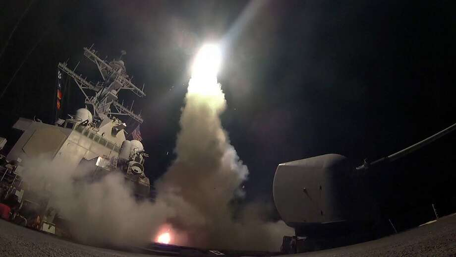 The  guided missile destroyer USS Porter fires a Tomahawk cruise missile at a Syrian air base on Friday. Photo: Ford Williams, Associated Press