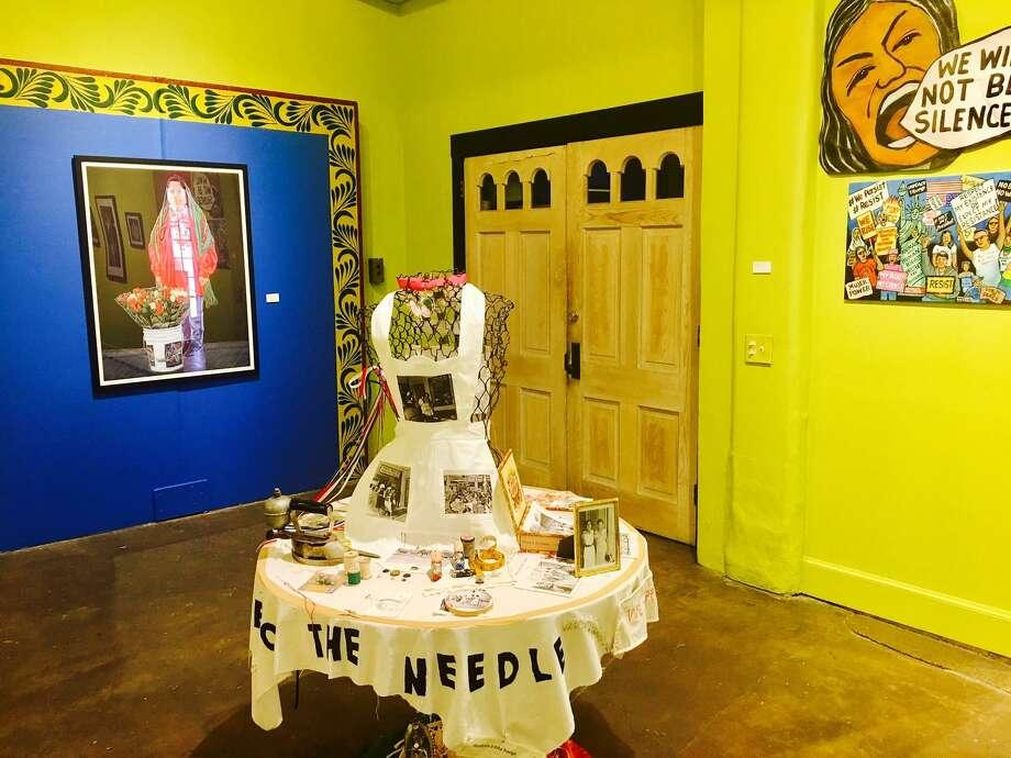 "One of the works in a new show, ""Aqui Estamos y No Nos Vamos,"" at the Esperanza Peace & Justice Center. Photo: Courtesy / Courtesy"