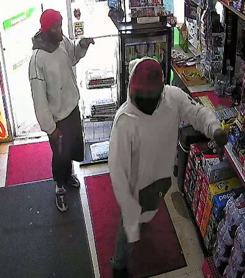 """Police described the two robbers who stormed into a Baytown store and shot the clerk on April 9 as two black males, the first approximately 5'10, approximately 200 pounds, wearing a gray hoodie, baggy shorts and a red hat. The second suspect, also about 5'10"""", weighing approximately 250 pounds, was wearing a white hoodie, dark shorts and a black mask covering his face, police said. Photo: Baytown PD"""