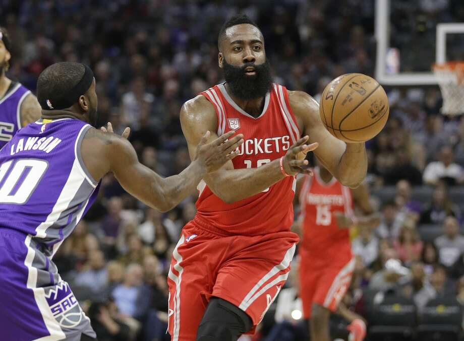 Houston Rockets guard James Harden, right, passes against Sacramento Kings guard Ty Lawson during the first half of an NBA basketball game, Sunday, April 9, 2017, in Sacramento, Calif. (AP Photo/Rich Pedroncelli) Photo: Rich Pedroncelli/Associated Press
