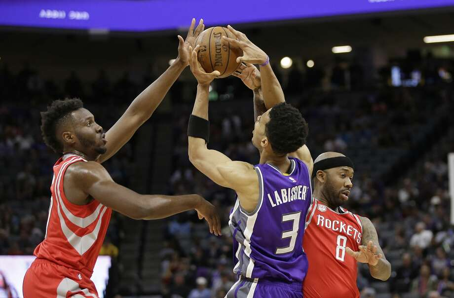 Sacramento Kings forward Skal Labissiere, center, battles for the rebound with Houston Rockets' Chinanu Onuaku, left, and Bobby Brown, right, during the second half of an NBA basketball game Sunday, April 9, 2017, in Sacramento, Calif. The Rockets won 135-128. (AP Photo/Rich Pedroncelli) Photo: Rich Pedroncelli/Associated Press