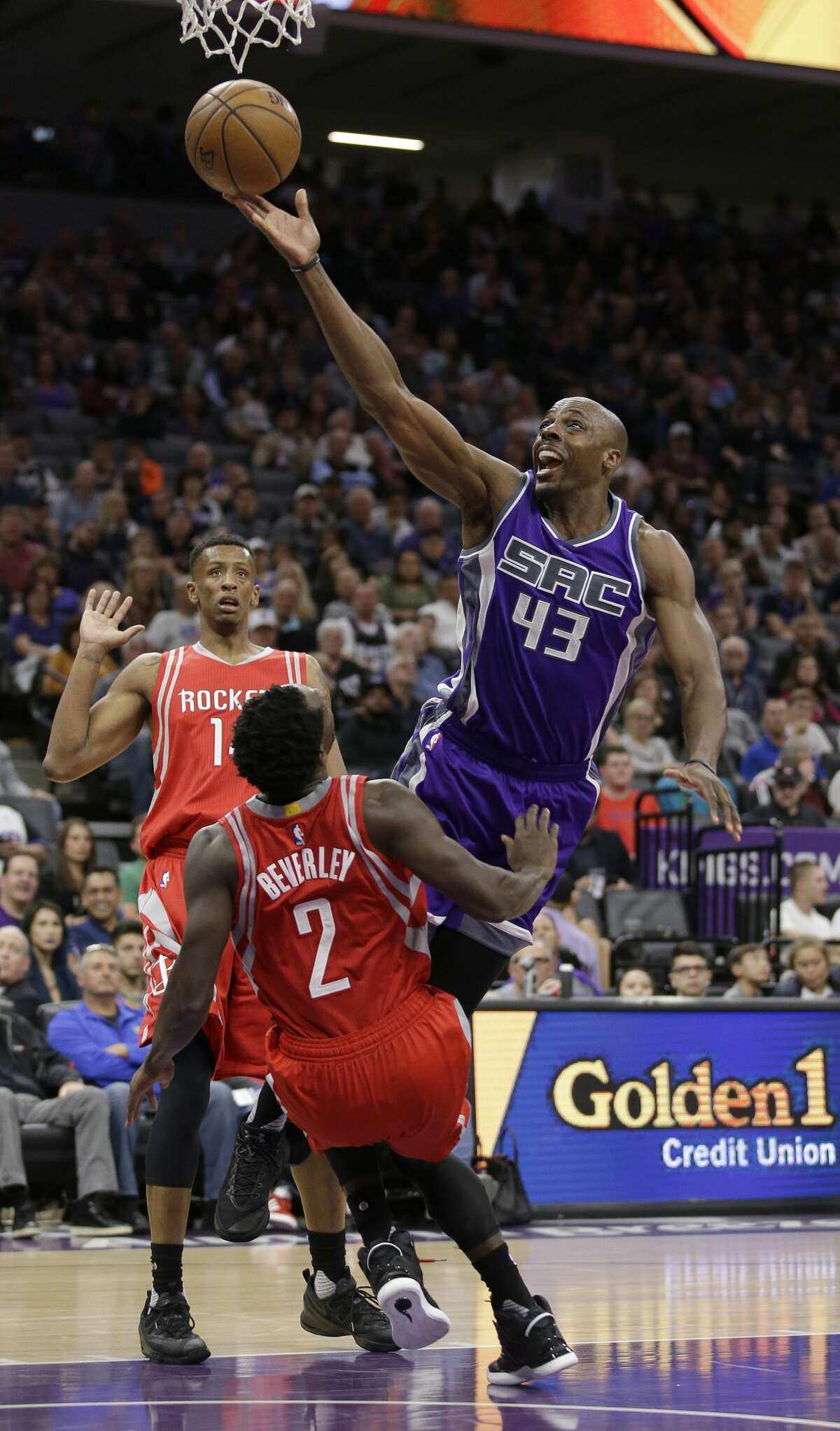 Sacramento Kings forward Anthony Tolliver, right, is fouled by Houston Rockets guard Patrick Beverley, left, during the second half of an NBA basketball game Sunday, April 9, 2017, in Sacramento, Calif. The Rockets won 135-128. (AP Photo/Rich Pedroncelli)