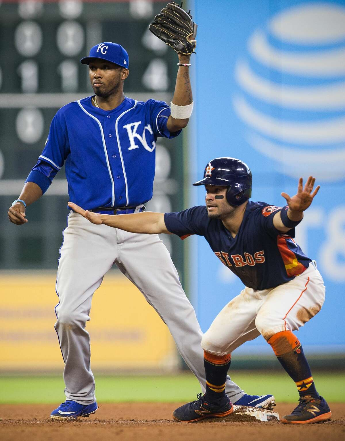 Houston Astros second baseman Jose Altuve (27) signals safe after stealing second under the tag of Kansas City Royals shortstop Alcides Escobar during the eighth inning of a major league baseball game at Minute Maid Park on Sunday, April 9, 2017, in Houston. ( Brett Coomer / Houston Chronicle )