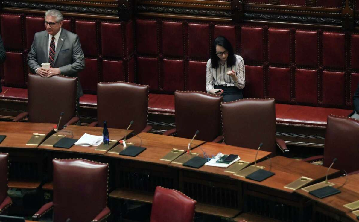 Senator James Tedisco, left, stands on the floor of the Senate as he waits for the start of the session on Sunday, April 9, 2017, in Albany, N.Y. (Paul Buckowski / Times Union)