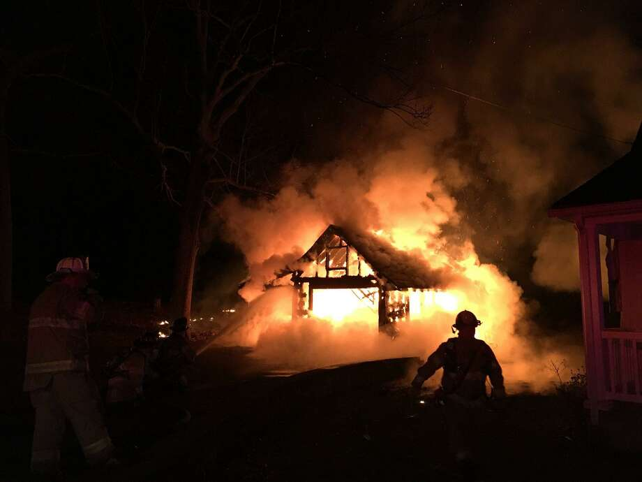 An intense garage fire on Sunday, April 9, 2017 destroyed a garage and two vehicles on Blackberry Hill Road in Beacon Falls. The side of a nearby home was also heavy damaged by the heat and flames. No one was injured in the blaze. Photo: Contributed Photo /Jeremy Rodorigo And Tim Hanks Via Beacon Hose Co. 1 /Facebook
