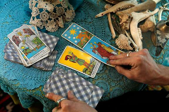 Hangedman Company owner Matthew Drewry reads tarot cards at MacArthur Annex, a retail complex of 24 shipping containers on Wednesday April 5, 2017, in Oakland, Calif.