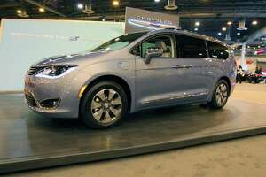 The 2017 Chrysler Pacifica hybrid minivan is available in an exclusive teal color.