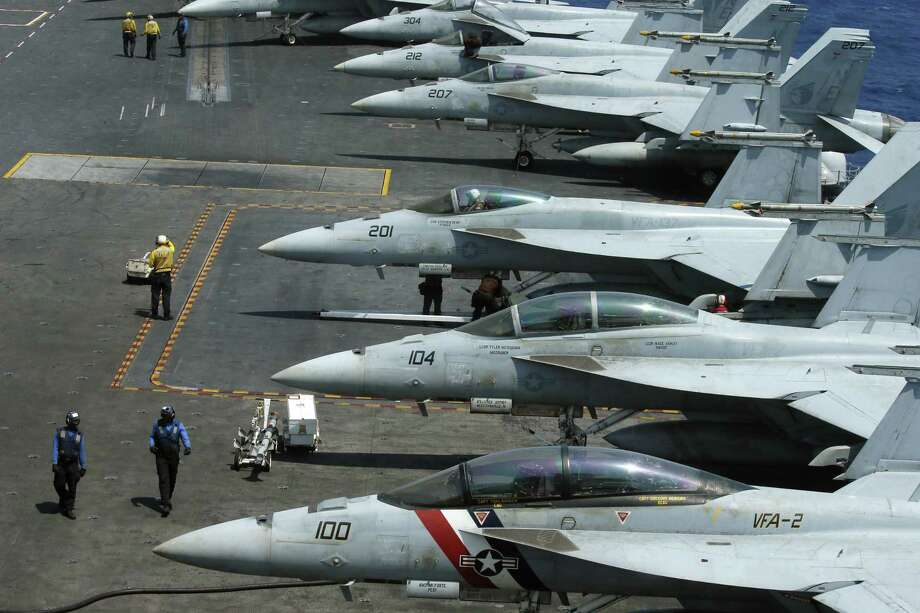 F-18 fighter jets line the deck of the USS Carl Vinson, which is making its way toward the Korean Peninsula as North Korea prepares to mark the anniversary of the birth of its founder. Photo: Bullit Marquez /Associated Press / Copyright 2017 The Associated Press. All rights reserved.