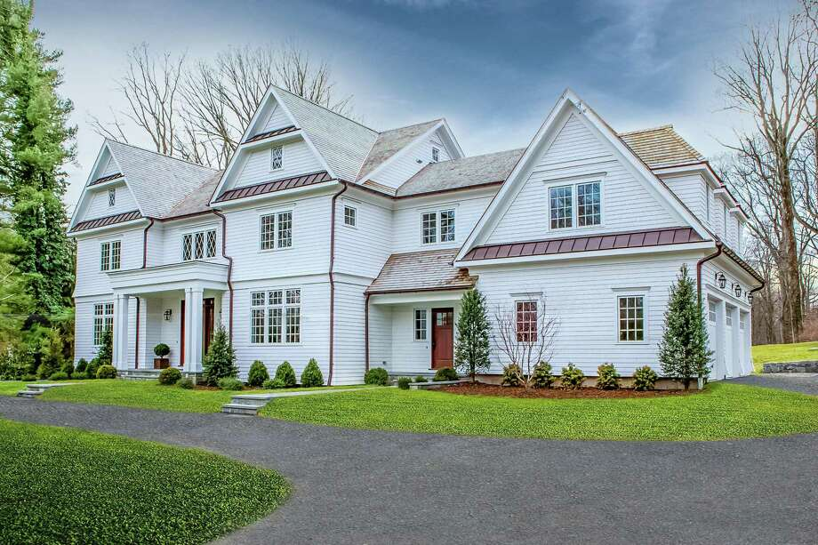 The newly constructed white colonial house at 61 Stony Brook Road was designed and crafted in 2016 by Renato Gasparian Associates.